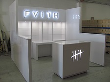 /custom-trade-show-booth-10x10-hard-wall-with-backlit-signs-1