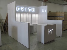 /custom-trade-show-booth-10x10-hard-wall-with-backlit-signs-2