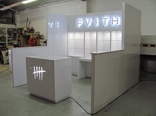/custom-trade-show-booth-10x10-hard-wall-with-backlit-signs-3